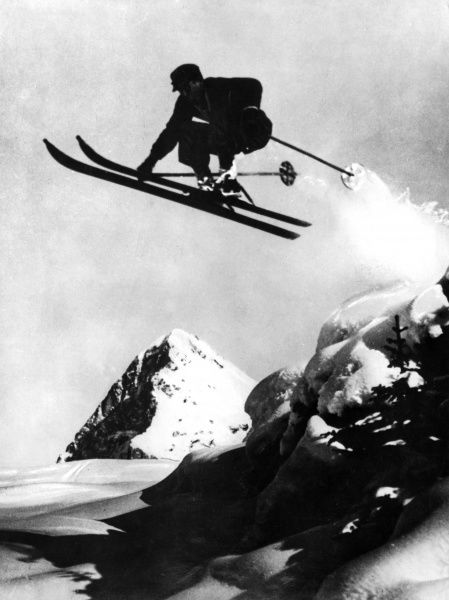 An athletic skier flies through the air! Date: 1930s