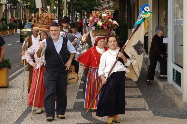 A folklore group from the village of Camacha, walking through the streets of Funchal, the capital city of Madeira