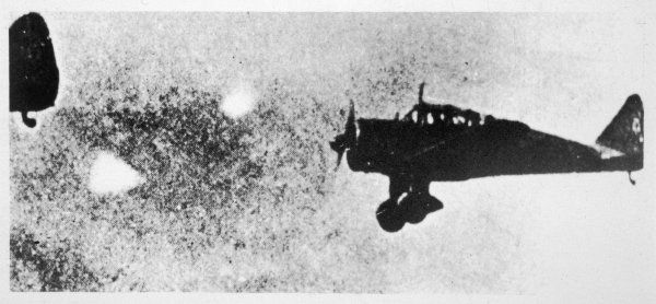This photo is said to show two 'foo-fighters' accompanying a flight of Japanese Takikawa- Kawasaki 98 fighters over the Suzuka Mountains, Central Japan