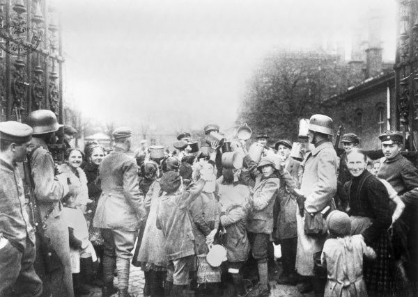 Children clamour for food in Munich during the severe economic crisis that followed the First World War