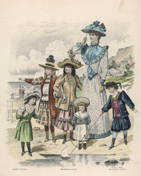 A French family in their best clothes for a walk on the beach