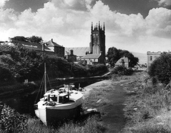 Beside the Clyde - Forth Canal, nestles the village of Kirkintilloch, with St. Mary's Church, Dunbartonshire, Scotland. Date: 1960s