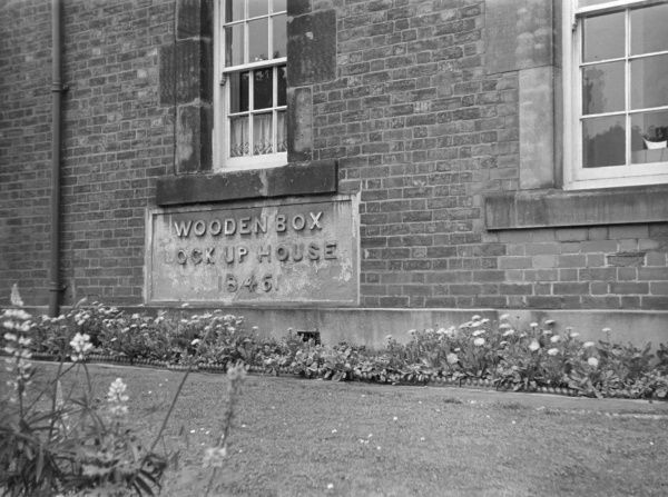 This rather amusing foundation stone, with its inscription of 'Wooden Box Lock Up House, 1846', is at Woodville Police Station, Derbyshire, England. Date: 1846