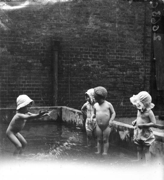 Toddlers playing outdoors at the Foundling Hospital site in Guildford Street, London