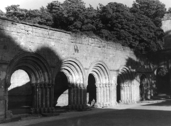 Norman arches at Fountains Abbey, Yorkshire, England, which was founded in 1132. It lies in the valley of the River Skell, near Ripon. Date: 12th century