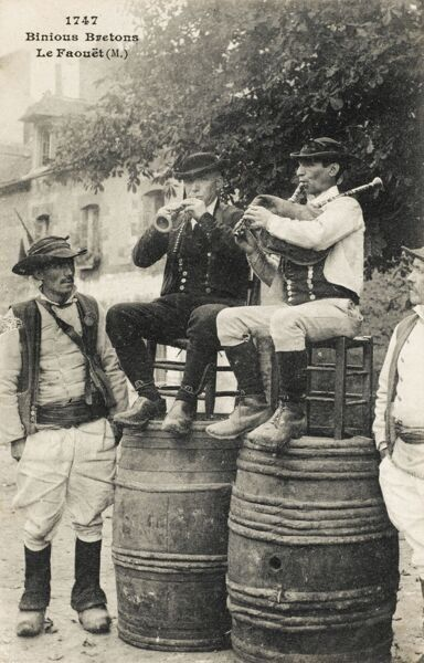 France - Le Faouet - Morbihan Departement - Binious Breton Men playing a horn and bagpipes