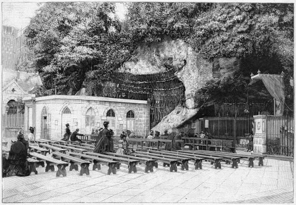 Pilgrims at the grotto where Mary, mother of Jesus, appeared to Bernadette Soubirous in 1859