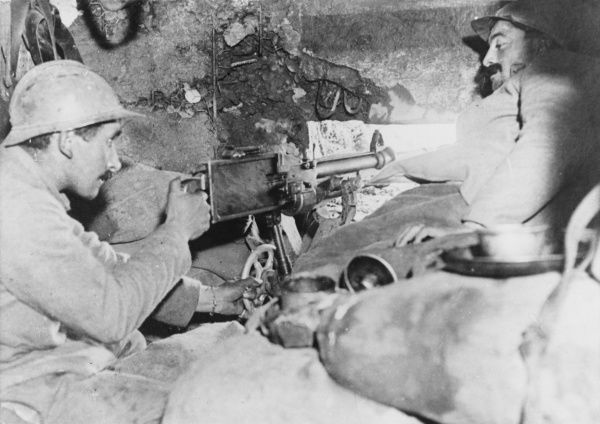 Inside a French defensive bunker with a machine gun in action during World War I