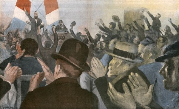 An appreciative crowd clap and cheer a speaker standing in front of crossed tricolore flags at an election meeting in France Date: 1902