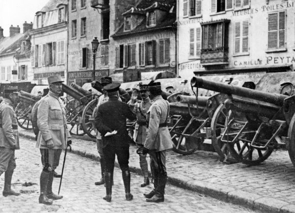 French generals Mangin, Duparge and Petain in Villers-Cotterets, northern France, towards the end of the First World War. They are in the main square, looking at trophies of artillery taken from the Germans