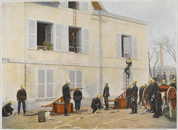 French sapeurs-pompiers use hand pumps at the scene of a fire
