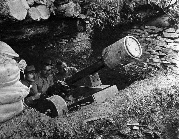 An 80mm mountain-gun, ready to be fired by a French artillery regiment. The gun was able to fire mines weighing up to 236lb