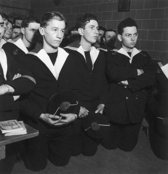 The young sailors listen when one of their comrades performs mass