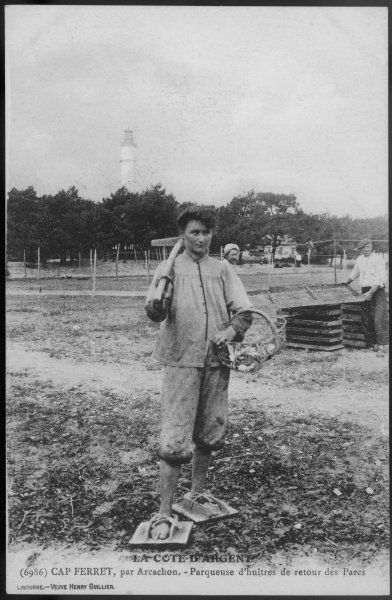 A parqueuse d'huitres - oyster gatherer - of Cap Ferret, near Arcachon in south- west France. Her shoes may lack Parisian chic but are eminently practical