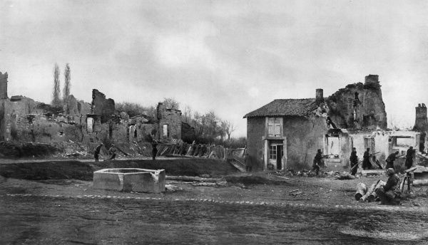 Photograph showing French troops recapturing the village of Ville-en-Woeuvre from the Germans, near the French fortress of Verdun in October 1914