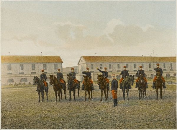 French cavalrymen practice using their sabres while mounted