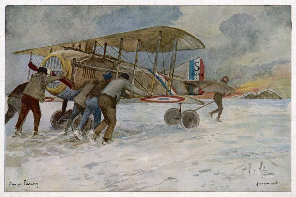 French ground crew return the SPAD aeroplane to its hangar, in order to protect it from the freezing weather