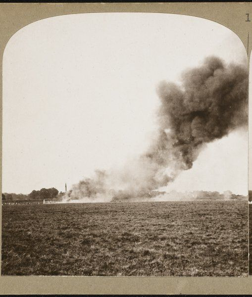 A French village set on fire by the Germans in their retreat during the First World War