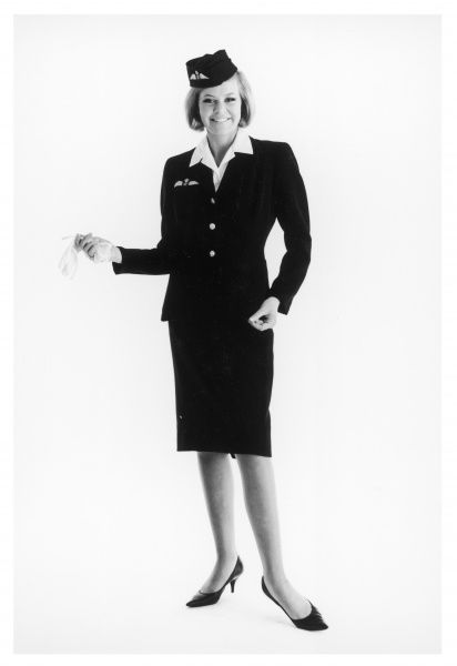 Full length portrait of a smiling air hostess