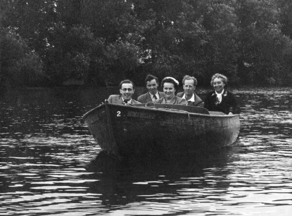 Five Friends In A Very Small Motor Boat On The River