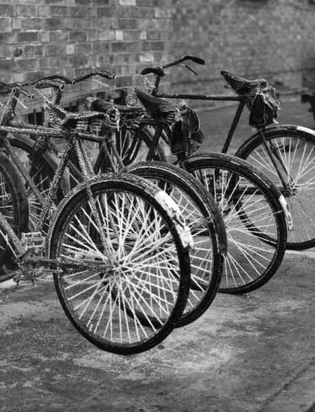 Frost bike - hoar frost on some parked bicycles! Date: 1940s