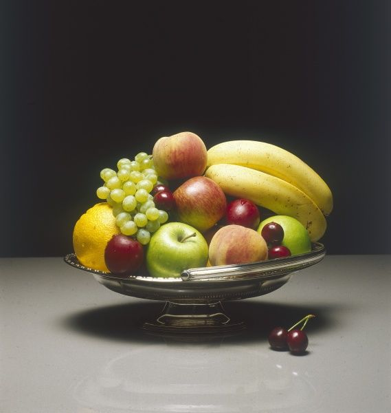 A bowl of mixed fruit : apples, peaches, grapes, bananas and oranges. Date: 1981