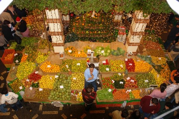 Aerial view of a colourful fruit stall in the local market in Funchal, Madeira, on the night before Christmas eve (23 December) during the annual Noite de Mercado dos Lavradores (workers' market night), which lasts all through the night
