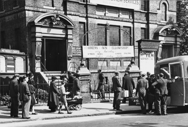 Refugees arriving at the distributing centre organised by the Fulham Borough Council in London during World War II