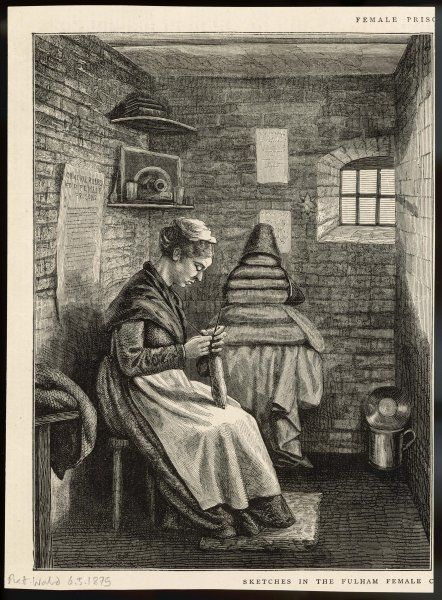 A women working in her cell at this female prison