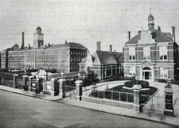 A view of the Fulham workhouse on Fulham Palace Road, south west London. Designed by Alfred Gilbert, the main building (left) was erected in 1848-9. The site later became Fulham Hospital and then Charing Cross Hospital