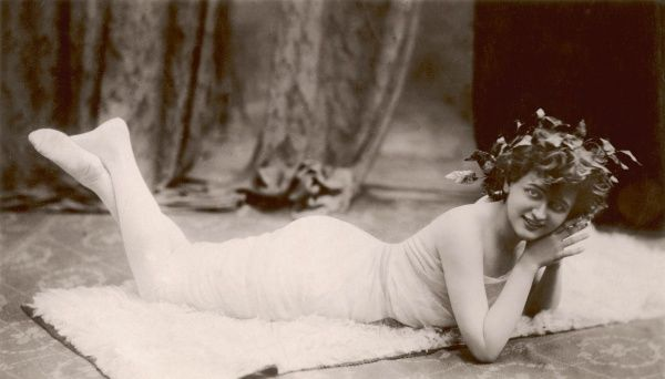 GABY DESLYS French singer and music hall artiste, lying on a white rug