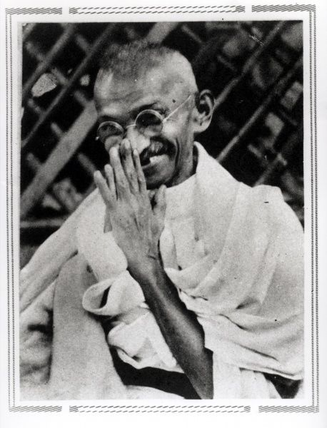 The photograph shows Gandhi waving to his followers a few hours before he was taken prisoner