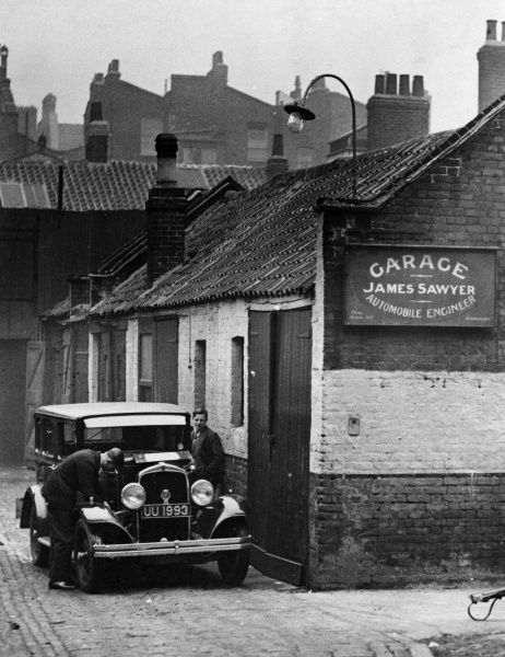This unassuming garage of James Sawyer, near Buckingham Palace, London, has a secret past - it was once Queen Victoria's cow shed! Date: 9 April 1930