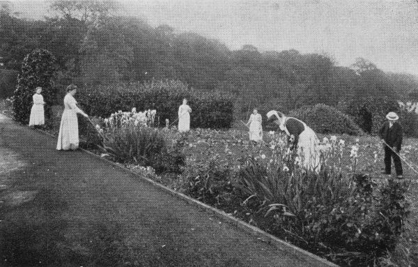 Inmates tending flower beds in the garden of the Midland Counties Inebriates Reformatory at Whittington near Chesterfield, Derbyshire