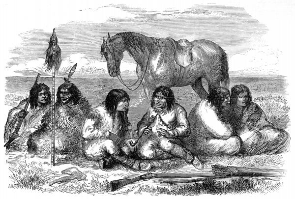 Image showing a group of male Prairie Cree Indians smoking long pipes and talking together. The Cree are wearing fringed buckskin and feathers in their hair, with rifles and a hatchet in the foreground and a horse in the background