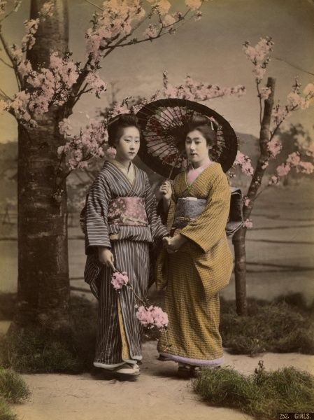 Two geishas and a parasol in Japan