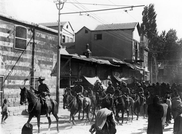 General Sir Harry Chauvel (1865-1945) of the Australian Imperial Force, escorted by a squadron of the 2nd Light Horse Regiment as bodyguard, riding through Damascus on horseback during the First World War