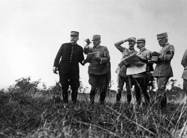 General Joseph Joffre (1852-1931), Commander of the French Army during the first half of the First World War (left) with General Luigi Cadorna (1850-1928), Italian Field Marshal, chief of staff of the Italian army, and other officers, studying maps