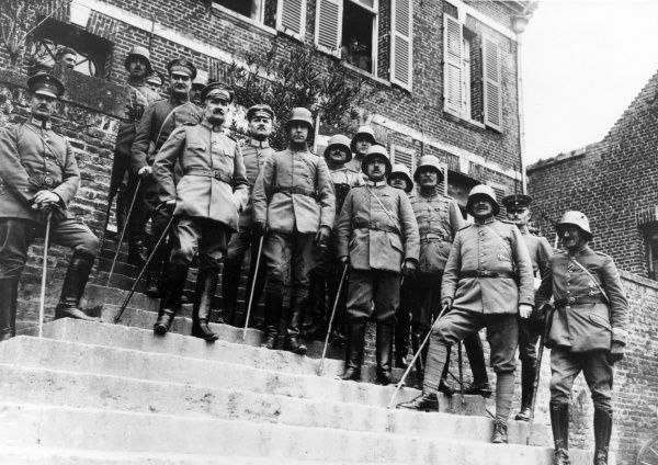 General Paschen, German artillery officer, Commander of 1st Division, together with staff officers standing on steps outside a building during the First World War. Date: circa 1914-1918