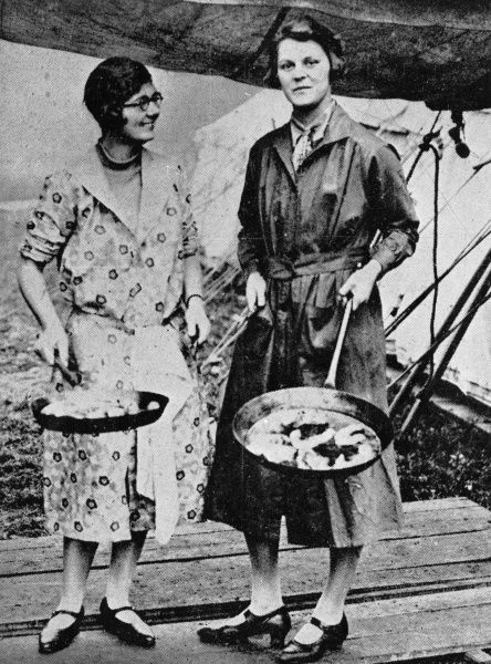 Lady Betty Butler (left) and Miss Collett Doughty armed with large frying pans; part of an organised response to the General Strike where canteens were set up in Hyde Park, London and staffed by well-known society ladies, in order to feed the