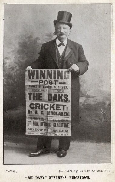 "A jolly gentleman (""Sir Davy"" Stephens of Kingstown)holding up a poster for The Winning Post run by Robert S Sievier. He used the publication to attack those he disliked on the turf. Date: circa 1904"