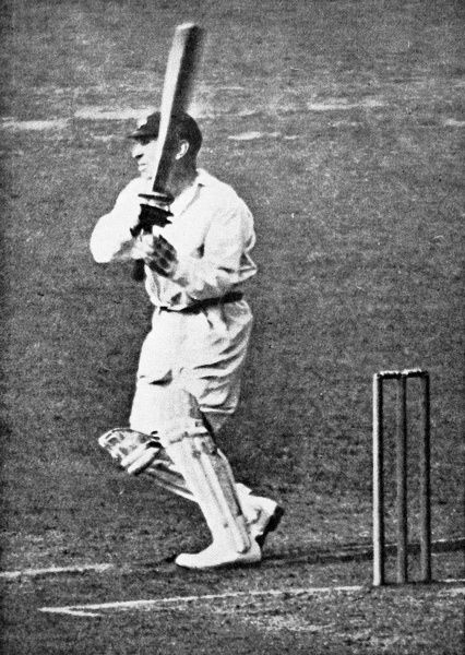Photograph of George Hirst, the Yorkshire and England cricketer, playing a strong leg-side shot. Hirst was one of Yorkshire's best-ever all-rounders, scoring 36,185 runs and taking 2,719 wickets