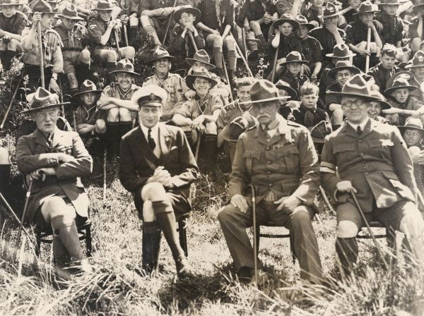 Prince George (Duke of Kent) poses with Baden-Powell at a jamboree of Norfolk and Suffolk scouts in Salhouse Broad, near Wroxham. With Lords Playfair and Albemarle