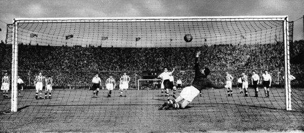 Photograph of George Mutch scoring a penalty to make the score 1-0 for Preston North End against Huddersfield Town in the last minute of the FA Cup Final, 30th April 1938