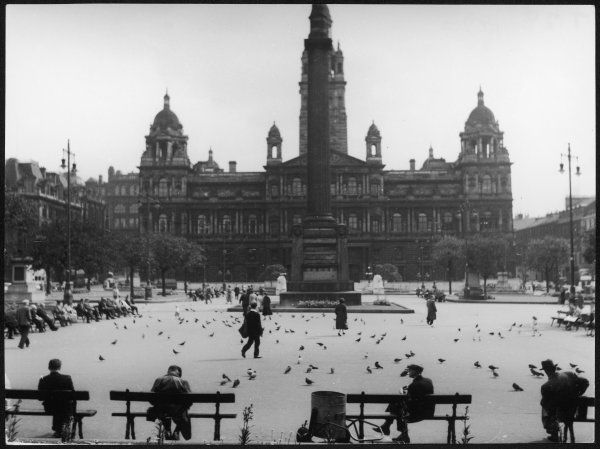 George Square in the centre of Glasgow, Lanarkshire, Scotland. This fine square in dominated by the Italianate Municipal Chambers and the Sir Walter Scott memorial column