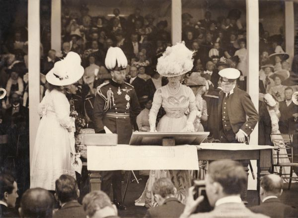 King George V and Queen Mary laying the foundation stone for the National Library at Aberystwyth, Wales. The Prince of Wales (later Edward VIII) and Princess Mary are also present