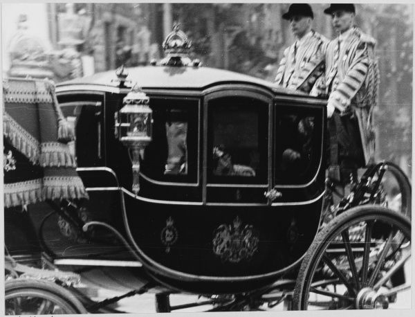 CORONATION The Royal state coach at the coronation of George VI; liveried footmen ride on the back