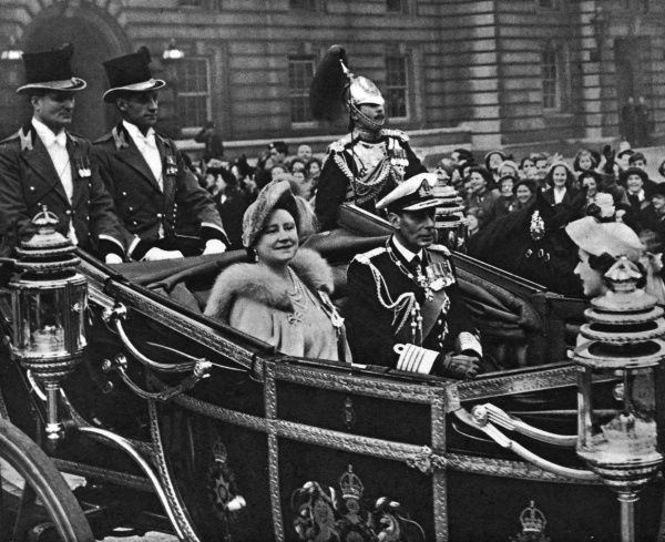King George VI and Queen Elizabeth, with Princess Margaret, in an open coach, leaving Buckingham Palace for the Festival of Britain dedication service at St Paul's Cathedral, London. Date: 3 May 1951