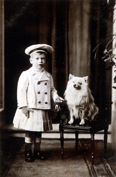 The future king, as a prince, with his pet Spitz