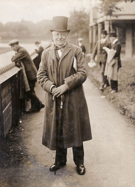 George William Coventry, 9th Earl of Coventry (1838-1930), known as Viscount Deerhurst until 1843, British Conservative politician and horseracing devotee. Seen here in coat and top hat, walking along a riverside path